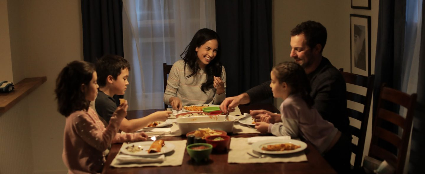 happy-family-eating-dinner-together